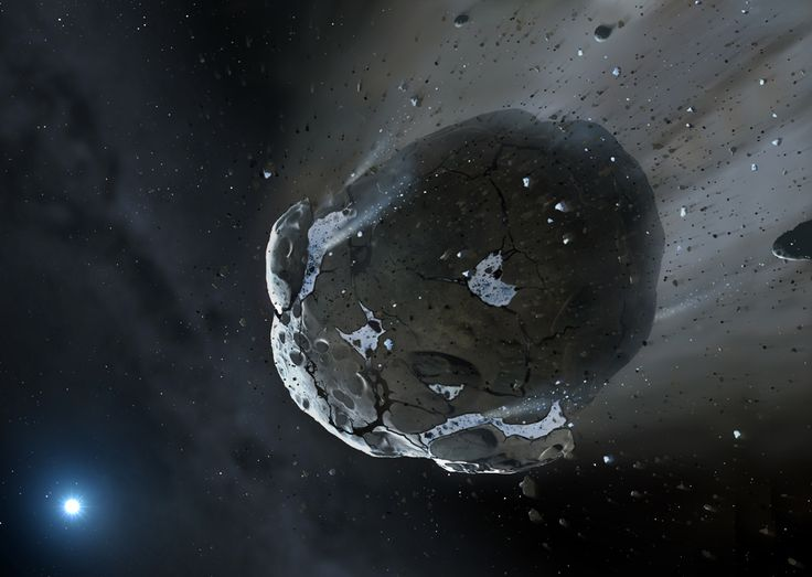 Artist's impression of a rocky and water-rich asteroid being torn apart by the strong gravity of the white dwarf star.