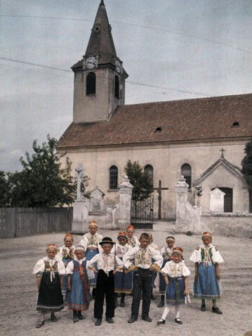 Children of Slovakia Stand Outside a Church in their Sunday Dress