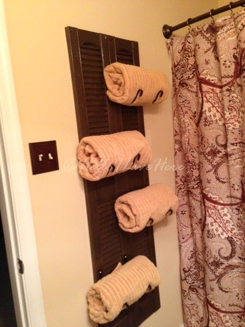 Get extra storage with this functional DIY Shutter towel rack wall hanging for your bathroom!