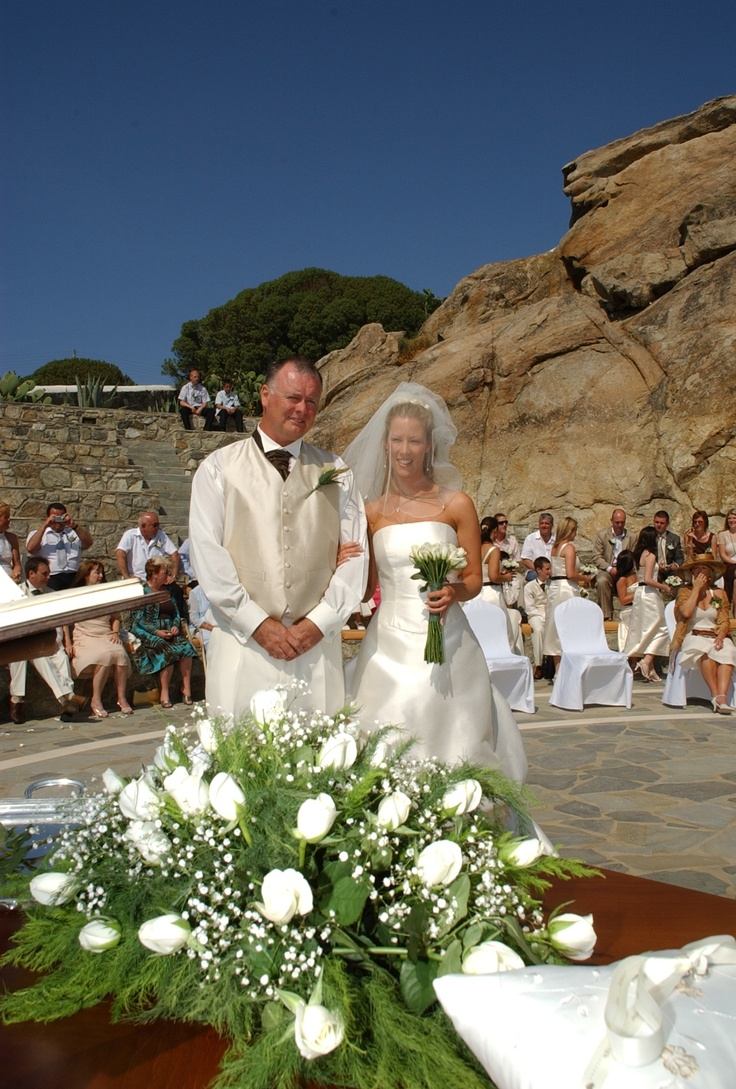 Family photo after the wedding ceremony at the amphitheater - Mykonos Grand Hotel & Resort