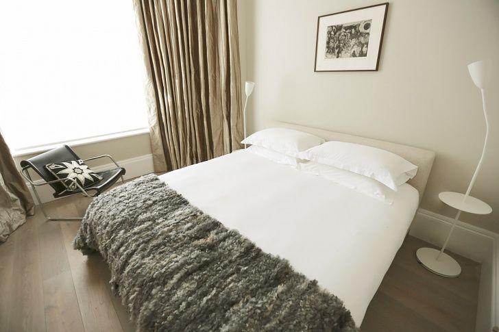 56 Welbeck Street | One Bedroom Apartment Bedroom | Vintage Yrjo Kukkapuro Chair | Tracey Boyd Cushion
