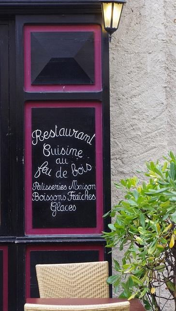 """Restaurant in la Cité de Carcassonne, """"cooking over a wood fire"""" France"""