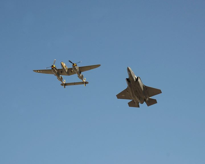 The P-38 Lightning flies alongside the F-35A Lightning II at Luke Air Force Base Ariz. April 1 2016. The heritage flight features the Air Forces Lineage of fighters from the vintage B-24 to the fifth generation strike fighter the F-35. (U.S. Air Force photo by Senior Airman Devante Williams)