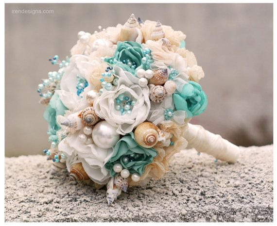 This bouquet made to order. Make the new one will take 2 weeks. ************************************************ This beautiful seashell wedding bouquet is a creative alternative to a flower wedding bouquet. This bouquet is an ideal for your beach wedding. The Bouquet is 100% handmade from top quality materials. The high amount of attention was paid to every single detail. Each flower in this bouquet is handmade by myself. The Bouquet is made from natural shells and fabric flowers with…