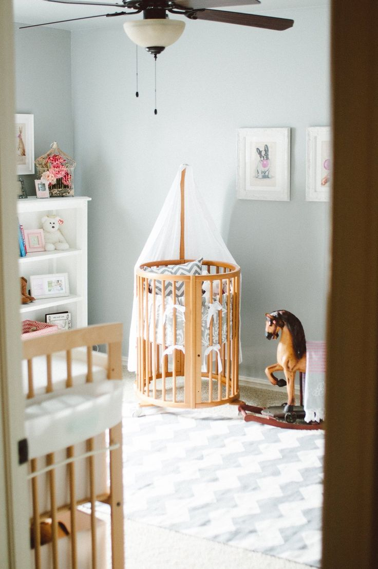 Soft grey painted walls in a girl's nursery