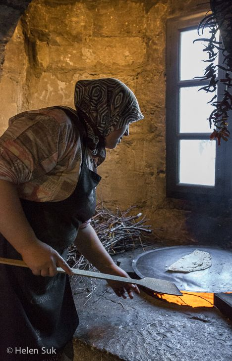 A woman makes gozleme, a traditional Turkish pancake at the Museum Hotel, Cappadocia. Click to learn more about this luxury cave hotel.