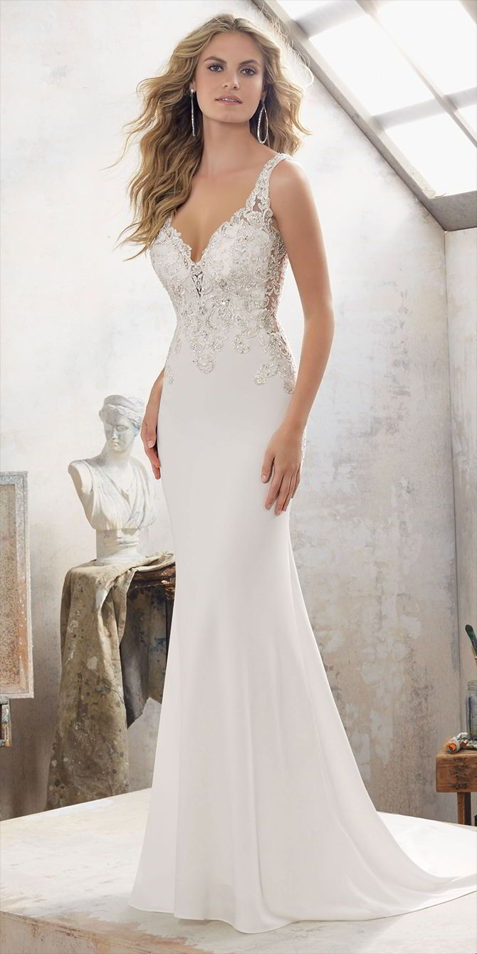 Crystal Beaded Embroidered Appliqués Adorn the Bodice and Open Back on This Stunning Crepe Sheath. Featuring Illusion Cutouts at the Waist. Covered Button Detail Accents the Back.