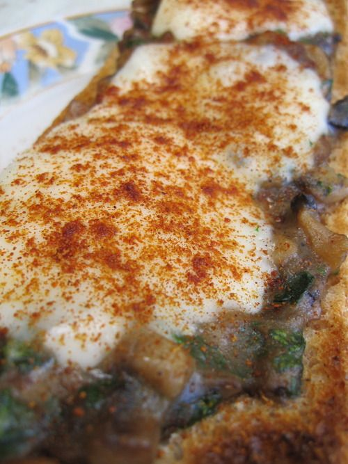 Zapiekanki - It's kind of like a pizza with a Polish twist: it has a mushroom sauce instead of a tomato one.