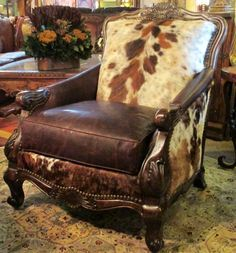 Ooo la la, What a great idea for the chair i want to re-upholster. The Buckley Chair and Ottoman. Great cowhide and leather chair.
