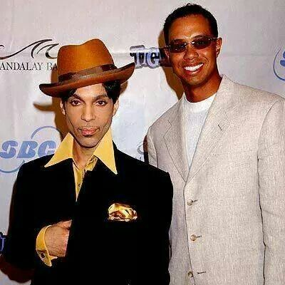 Prince and Tiger Woods...whoa!! Prince looks so bored here.