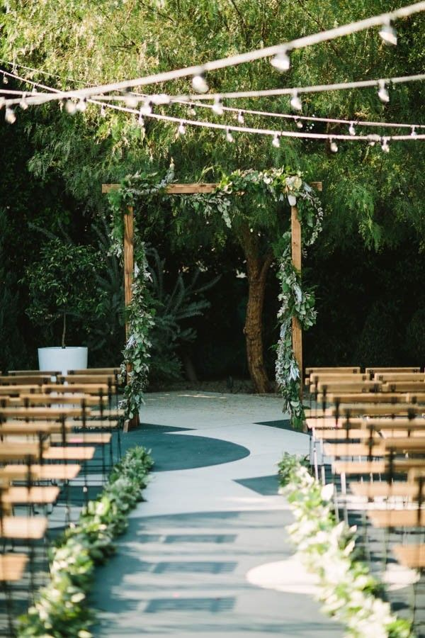 When you favor simple, straightforward decor elements, greenery is a wonderful choice to use throughout your rustic wedding. Cover an arch in greenery for your ceremony that will allow you two to be the focal point, while also offering a soft, natural background.