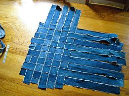 Link is not in English, but a cute, easy way to make a bag with all our old holey jeans.