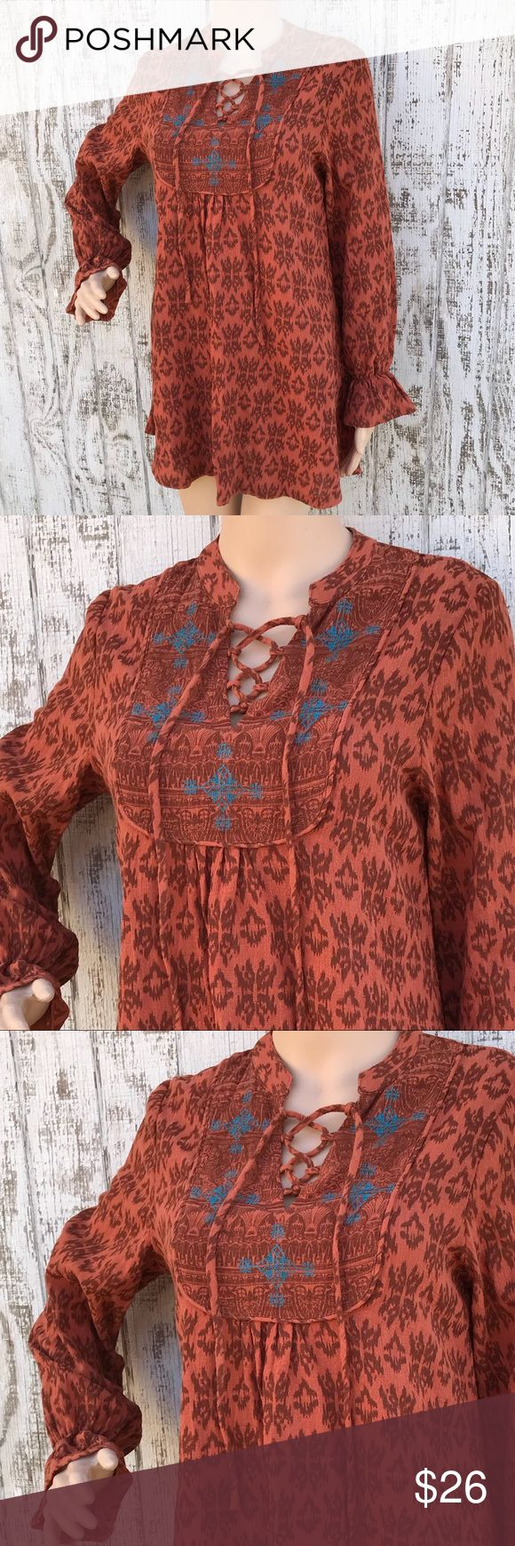 Hayden LA BoHo Tribal Look Tunic Hayden LA BoHo Tribal Look Tunic Size Small Like New 19 inches across the front armpit to armpit  30 inches in length shoulder to hem  Earthy Rust Brown Tone with great detail at the bodice Tie Front lacing Fabulous ❤️ Hayden LA Tops Tunics