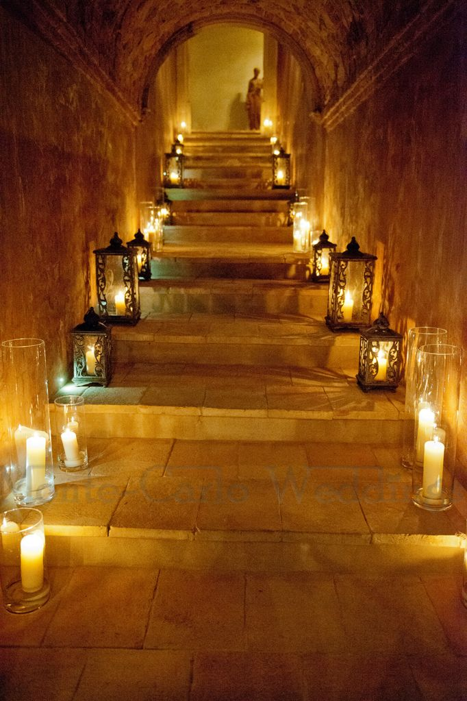 Light the way from cocktail to dinner and dinner to dancing with hurricane lamps. Candles are always dramatic! Wedding by Monte-Carlo Weddings.