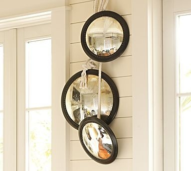 Round, convex mirrors from Pottery Barn. unbreakable security mirrors