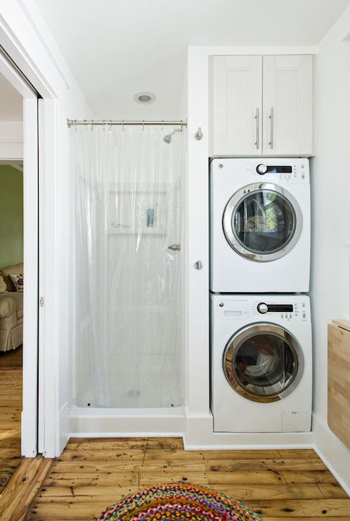 Small bathroom with a corner shower stall and washer and dryer. Description from pinterest.com. I searched for this on bing.com/images