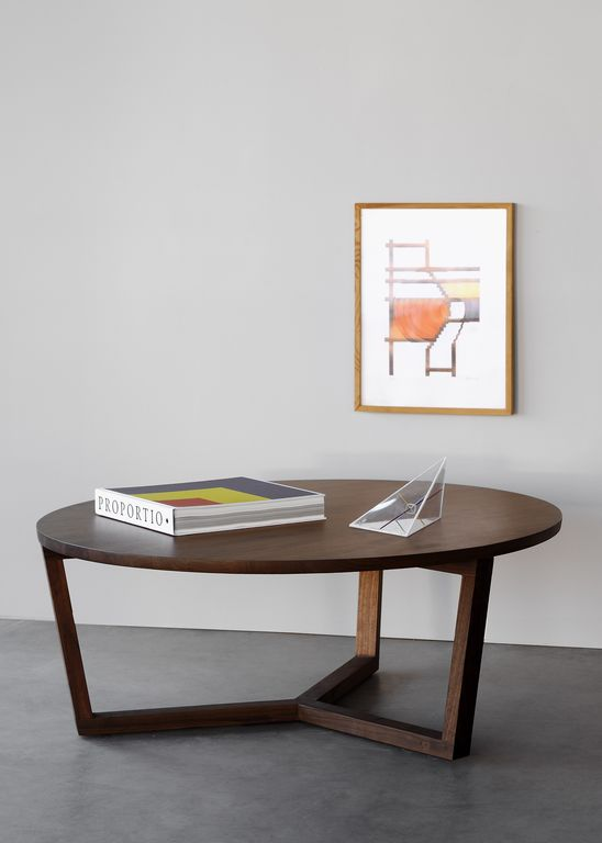 TRIPOD COFFEE TABLE in walnut by Ethnicraft. A result of the label's collaborative effort with Toronto-based designer Heidi Earnshaw, the Tripod coffee table is a marriage between Japanese and Scandinavian architectural elements. In dark walnut, the coffee table is rich yet contemporary.