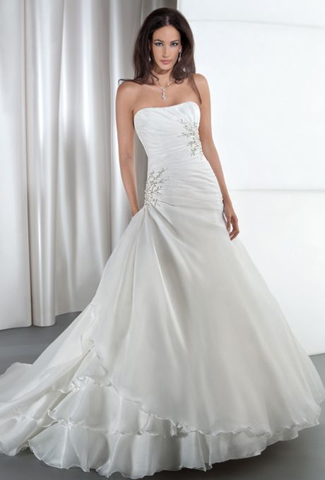 Brides: Demetrios - Illusions. Satin organza, strapless with asymmetrical ruching on bodice and corset back. Bodice in embellished with sprays of beaded appliques. A-line skirt features a side drape and attached train. Available in white and ivory.