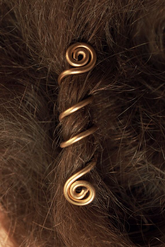 This listing is for a pair of custom long Viking hair beads, made to order. The spiral shape of these hair coils makes it easy to use and fits perfectly several beard- and hairstyles such as braids and dreadlocks! ________________________  ITEM DETAILS:  - Approximate bead length: 6 cm (~2.36 inches) - Approximate weight: 1 ½ grams (~0,003 lbs) - Approximate spiral diameter: 7 mm (~0,27 inches) - Material: 18 gauge aluminum wire ________________________  Here is a quick video tutorial on how…