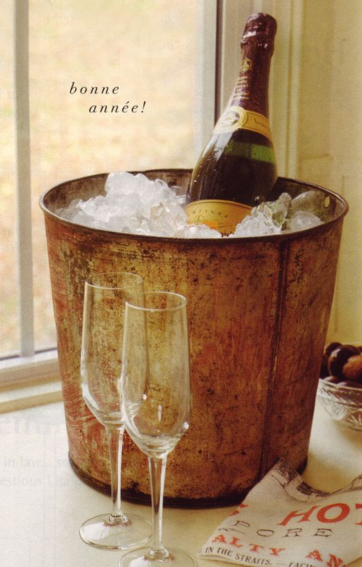 Put champagne in an ice bucket with dollar store flutes around