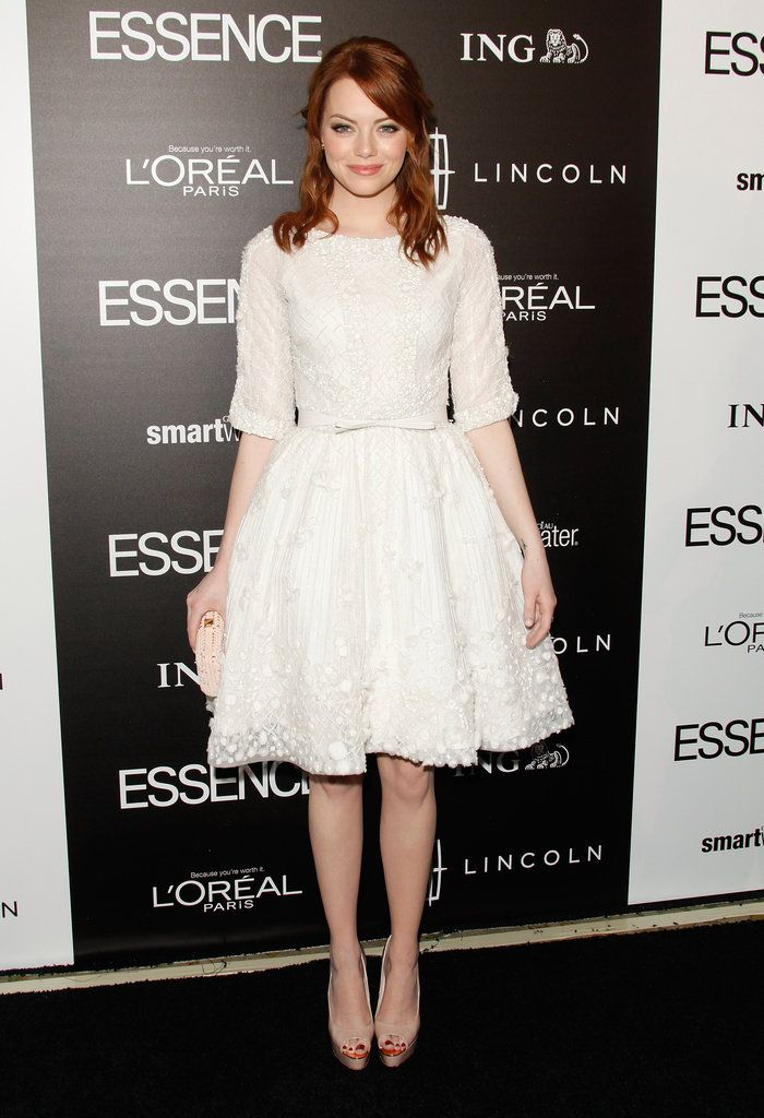 Emma loves a great full tea-length look — case in point: her white Elie Saab Couture dress and Brian Atwood heels ensemble at the 2013 Essence Black Women in Hollywood luncheon.