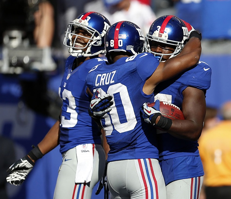 New York Giants running back Andre Brown, right, is congratulated by Victor  Cruz (
