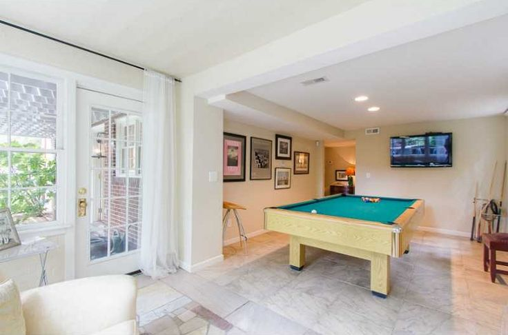 Contemporary Game Room with French doors, travertine tile floors