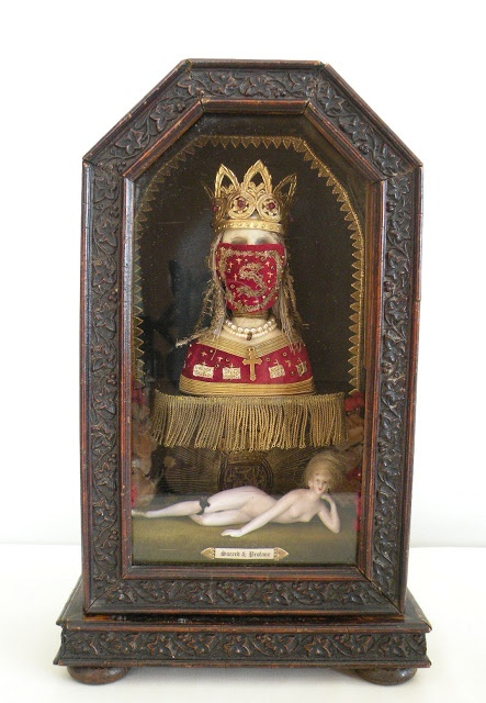SACRED & PROFANE   -   Antique German clock case with remade saint relic of clay, velvet and gold braid and foils. Antique doll figure.