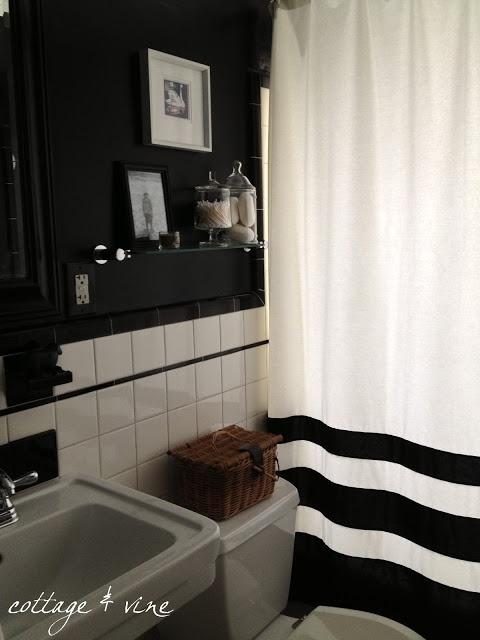 Curtain, black walls, white tile