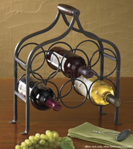 Six Bottle Wine Rack by Park Designs, Hand-forged natural iron with distressed wooden handle. A classic piece in substantial weight, suitable for tabletop or floor use.