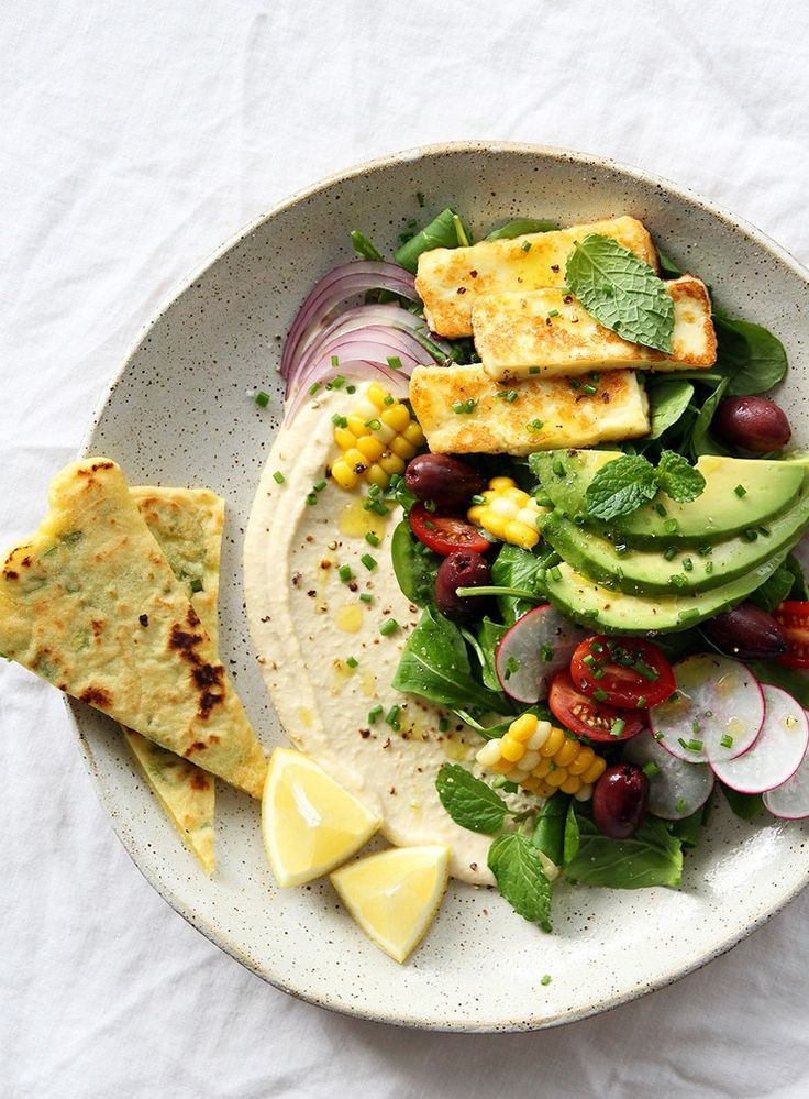 This salad is such a pleasure to eat. A perfect mixture of crunchy textures, with freshly made gluten-free flatbread and the creamiest hummus. Adapt the salad to suit whatever you have on hand.