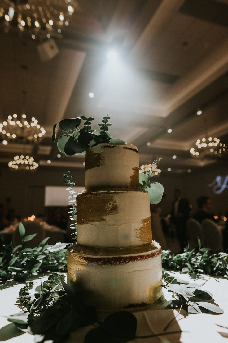gold, white and green wedding cake; PHOTOGRAPHY Joel + Justyna Bedford