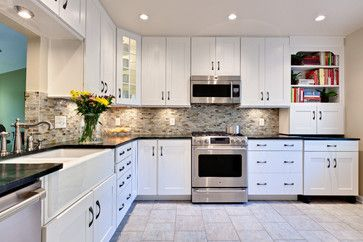 white cabinets with dark granite backsplash | white cabinets black