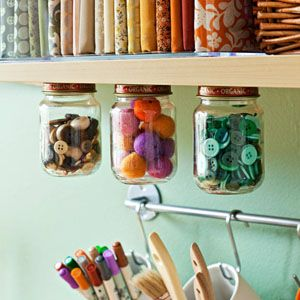 Storage Idea: Nail jar lids to underside of shelf and voila, storage jars. From http://fabricshopperonline.com/your-desperate-cry-for-craft-room-organization/