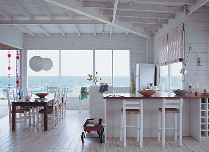 a white wood kitchen right by the sea. Designer Solange Van Dorssen