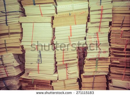 stack of old books and documents pile up together in retro color