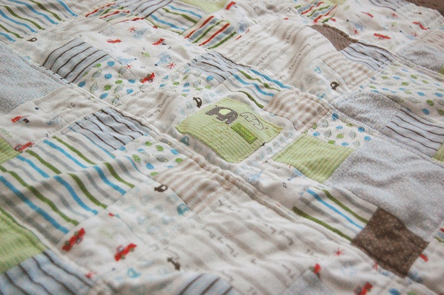Avery baby clothes quilt by jawkstudio, via Flickr