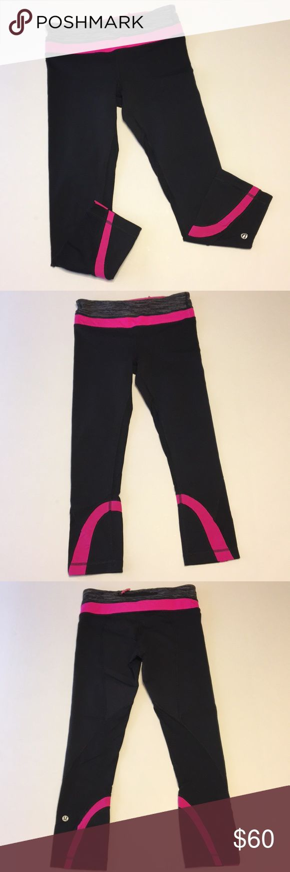 """Lululemon black/pink crop pant size 4 Lululemon black crop pants with hot pink trim.  size 4.  These have a mesh type material on the back of the legs.  It's not super see through, but slightly.  Logo is on the back of the left leg...it is cracking a bit, see photo.  Zippered pocket across the back of the waistband and hidden pocket in front.  Drawstring waistband.  No holes or stains or pilling.  Excellent condition.  Inseam is about 21"""".  Rise is 8"""".  Waist laying flat is 12"""". lululemon…"""