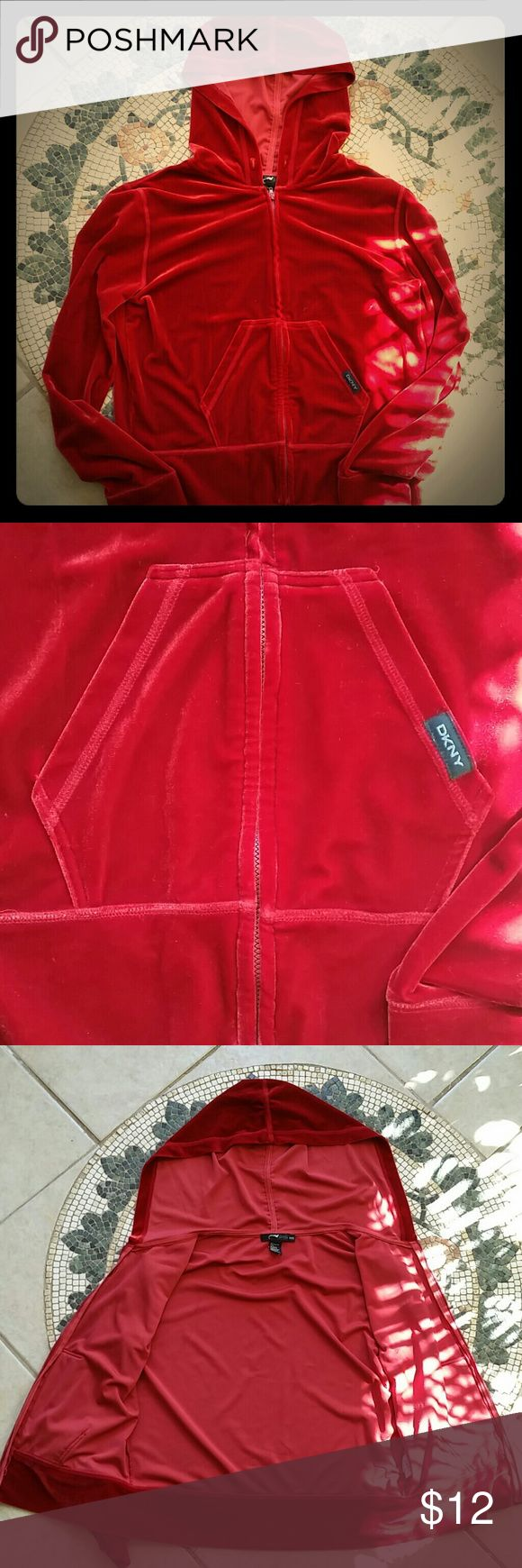 VINTAGE USED DKNY Zip-Up Velour Hoodie Rich red, vintage DKNY zip-up velour hoodie. It is PETITE small. Being vintage, it is in USED condition and shows obvious signs of wear as shown in pictures: on elbows,  zipper, tag, and fading and pilling on the inside. Hoodie is also missing cord to hood. Overall in good condition and great original piece to stand out.  * For accuracy the color is more like the second picture, not ketchup red. DKNY Jackets & Coats