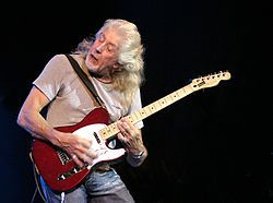 John Mayall,(born 29 November 1933) is an English blues singer, guitarist, and songwriter, whose musical career spans over 50 years. In the 1960s, he was the founder of John Mayall & the Bluesbreakers, a band which has included some of the most famous blues and blues rock musicians: Eric Clapton, Jack Bruce, Peter Green, John McVie, Mick Fleetwood, Mick Taylor, Don Sugarcane Harris, Harvey Mandel, Larry Taylor, Aynsley Dunbar, Dave Navarro.  The man's influence has been astounding.