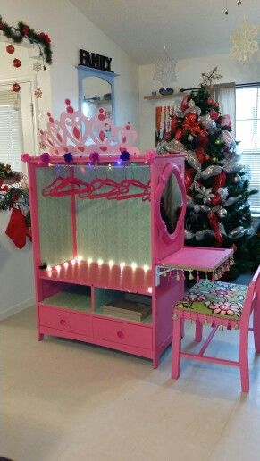 Lily's Princess Closet with vanity, made from a entertainment center.