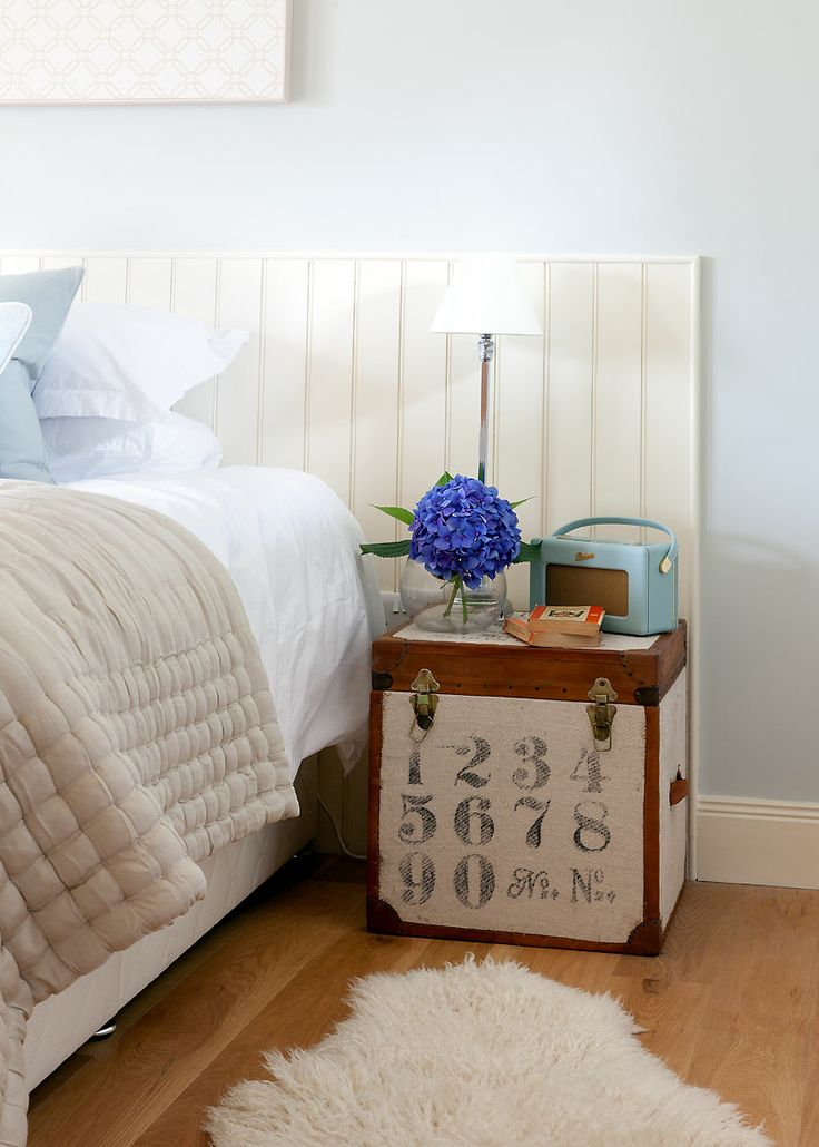 Country bedroom by Sally Homan for www.robertson-lindsay.com. Trunk bedside, tongue and groove headboard. Farrow and ball skylight.