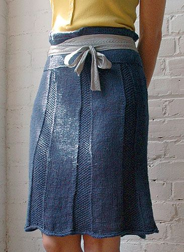 """Shiroshakar is a flirty high waisted skirt with seed stitch texture and cable pleat details. Shown in size Small Sizes Directions are for women's size X-Small. Changes for sizes Small, Medium, Large, 1X and 2X are in parentheses. Finished Measurements Waist — 26(30-34-38-42-46)"""" Length — 23"""" (from lower edge to top of ruffle Materials 8(9-11-12-13-14) Hanks Berroco Naturlin(50 grs), #6335 Indigo"""