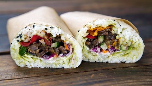 Recipe with video instructions: What happens when you combine sushi, Korean BBQ and a burrito? Here's a hint, it's magical. Ingredients: For bulgogi:, 4–5 garlic cloves, ½ onion, 4 Tbsp soy sauce, 4 Tbsp honey, 2 Tbsp mirin, 1 Tbsp sesame oil, 1 tsp black pepper, 1 lb ribeye, thinly sliced, 4 green onions, 2 tsp sesame seeds, For sushi rice:, 4 Tbsp rice vinegar, 5 Tbsp sugar, 1 ½ tsp salt, Small piece of kombu (dashima)     , ½ fresh lemon, 2 ½ cups warm, cooked sushi rice, To assemb...