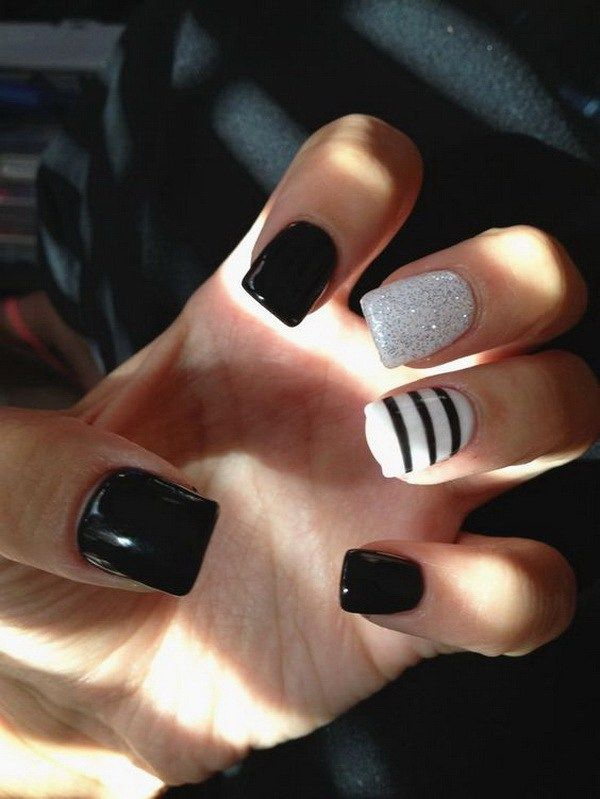 Black and White Nails with Glitter and Stripes.