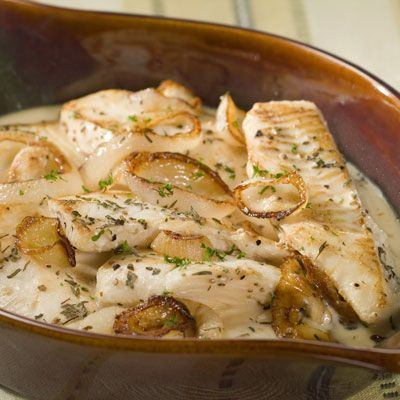 Tender fish fillets seasoned with herbs are topped with sautéed onions and baked in a light, velvety...