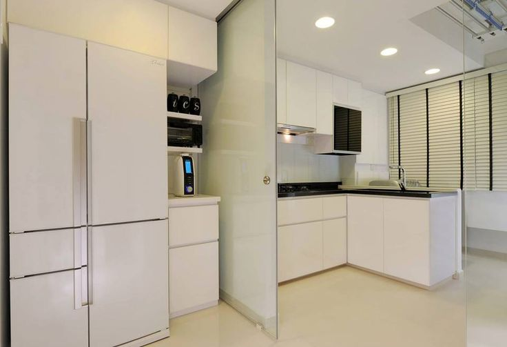 Beautifully done kitchen by Atliving for a HDB in Singapore. Love it how the wet and dry kitchen are separated by a sliding glass door.