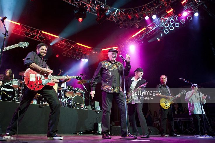 John Stamos (L) performs with Mike Love and Bruce Johnston (L) of the Beach Boys at Universal Studios on April 3, 2010, in Orlando, Florida. The Beach Boys were performing as part of the Mardi Gras concert series. (Photo by Matt Stroshane/Getty Images) Mike Love;John Stamos;Bruce Johnston