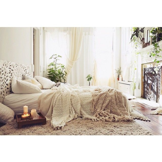 Relaxing, luxurious, and oh-so-comfy. What's not to like about this bedroom? #textiles #bed #plants
