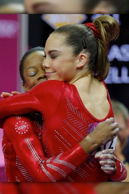 Hug Fest    Gymnasts McKayla Maroney and Gabby Douglas share a celebratory embrace.